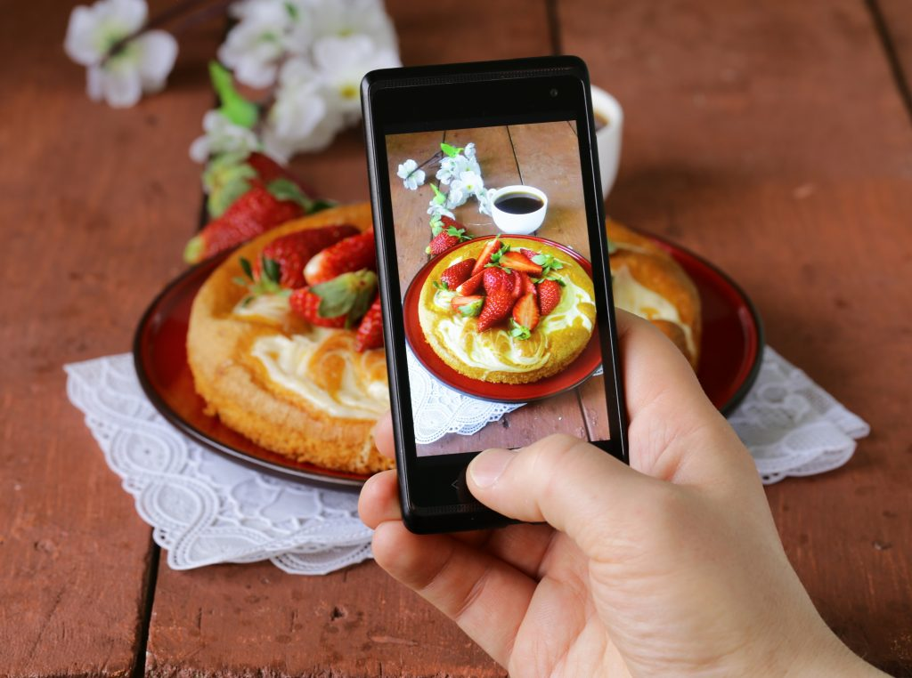 040614. Photo: 123rf.com Stock Photo - smartphone shot food photo - vanilla cake with strawberries berry, blog, breakfast, camera, cell, cellphone, coffee, cook, delicious, dessert, dish, fruit, lunch, meal, mobile, modern, overlook, phone, photos, restaurant, served, shot, smartphone, snack, strawberry, sweet, table, taking, tasty, trend, vanilla cake